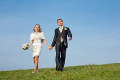 Couple walking along the field Stock Images
