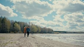 Couple Walking Along the Lake stock footage