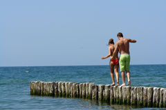 Couple walking along a pier Royalty Free Stock Photo