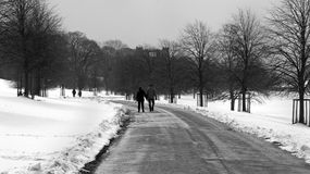Couple walking through a snow covered country scene in Derbyshire Royalty Free Stock Photo
