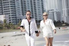 Couple walking along the sea shore Royalty Free Stock Image