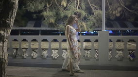 Couple Walking Along Street On Night Out. lovely romantic couple stock video footage