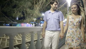 Couple Walking Along Street On Night Out. lovely romantic couple. Couple Walking Along Street On Night Out stock video footage
