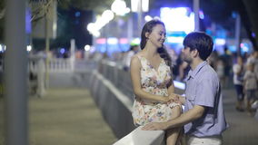 Couple Walking Along Street On Night Out. lovely romantic couple. Couple Walking Along Street On Night Out stock footage