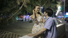 Couple Walking Along Street On Night Out. lovely romantic couple stock video