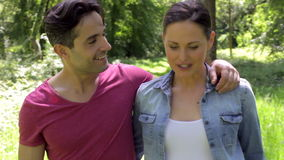 Couple Walking Along Summer Woodland Path Together stock video footage