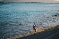 Couple walking alongside the beach royalty free stock photo