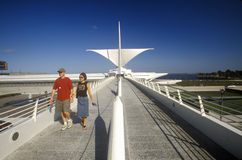 Couple walking around exterior of Milwaukee Art Museum on Lake Michigan, Milwaukee, WI Stock Photo
