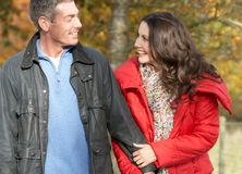 Couple Walking Through Autumn Park Royalty Free Stock Images