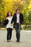 Couple walking by autumn park Stock Image