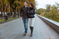 Couple walking in autumn park Royalty Free Stock Photos