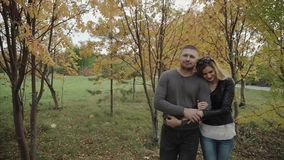 Couple walking in the autumn park stock footage
