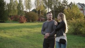 Couple walking in the autumn park. HD stock video footage