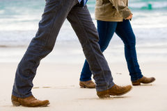 Couple Walking Away on the Beach Stock Image