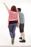Couple walking away in estudio Royalty Free Stock Images