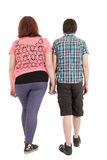 Couple walking away in estudio Stock Images