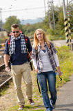Couple walking with backpack in train station Royalty Free Stock Photo