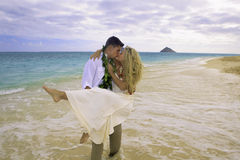 Couple walking on the beach Stock Photos