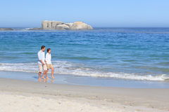 Couple walking on the beach. Enjoying couple walking on the beach Royalty Free Stock Image