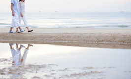 A couple walking on the beach Stock Photography