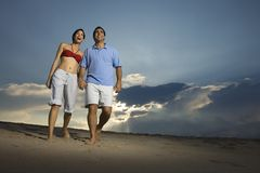 Couple walking on beach. Stock Image