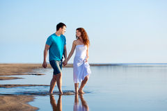 Couple walking on beach Royalty Free Stock Photography