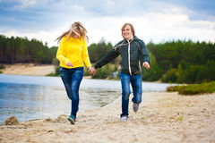 Couple are walking on the beach Stock Photo