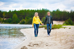 Couple are walking on the beach Stock Image