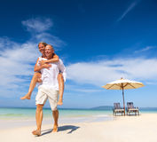 A couple walking on the beach Royalty Free Stock Photography
