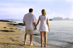 Couple walking on the beach Stock Photos