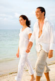 Couple walking at the beach Stock Photography