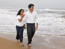 Couple walking in the beach. Asian couple walking in the beach Stock Image