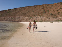 Couple walking on a beach in baja california Stock Photos