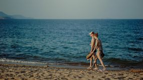 Couple Walking on the Beach at Daytime Royalty Free Stock Images