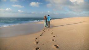 Couple Walking On Beach Enjoying Sunset Vacation On Romantic Honeymoon Travel stock footage