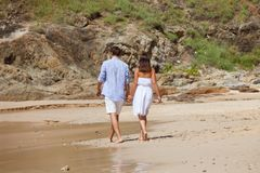 Couple walking on beach royalty free stock image