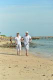 Couple walking on beach Royalty Free Stock Photo