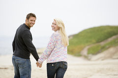 Couple walking at beach holding hands Royalty Free Stock Image
