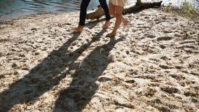 Couple walking on the beach stock footage