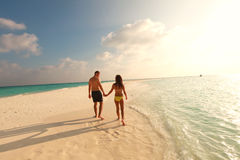 Couple walking on the beach maldive sunset lovely day sand Royalty Free Stock Photos