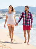 Couple walking on beach near sea Royalty Free Stock Image