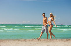 Couple walking on the beach. Picture of happy couple walking on the beach Royalty Free Stock Photos