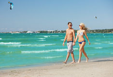 Couple walking on the beach Stock Photography
