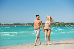 Couple walking on the beach Royalty Free Stock Images
