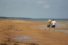 Couple walking on the beach in Prince Edward Island Royalty Free Stock Image