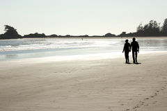 Couple walking on the beach 2 Stock Image