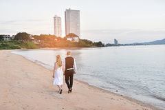 Couple walking on the beach. With sunset Royalty Free Stock Photography