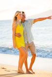 Couple Walking on the beach at Sunset, Romantic Vacation Royalty Free Stock Photo