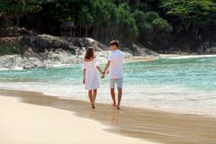 couple walking on beach together, back view Royalty Free Stock Photography