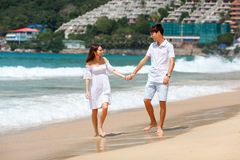 couple walking on beach together Stock Photo